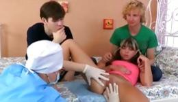 Two inexperienced dues are taking care of the sweet young chick's breasts