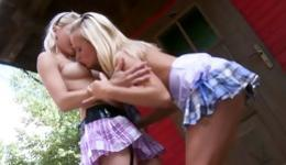 Two blonde babes are wearing sexy miniskirts and they are making out