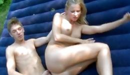 Sweet naked blonde is outdoors riding a giant dick getting pleasured deep
