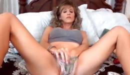 Hot mature lady is pleasing her sweet vagina hole with a long dildo