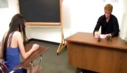 Young student in glasses came into the class to her attractive professor