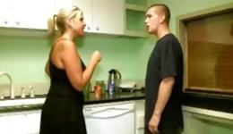 Beautiful housewife having fun with her young lover in the kitchen