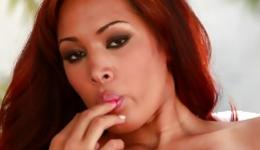 Red haired gorgeous woman is pressing her adorably tight sweet pussy
